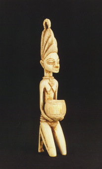 Yoruba Ivory Sculpture of a Kneeling Woman