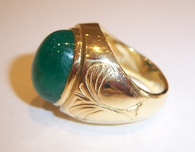 18 Karat Gold Ring Set with a Cabachon Colombian Emerald