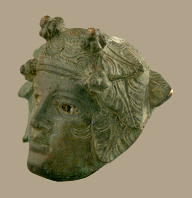 Roman Bronze Applique of the Head of Bacchus with Inlaid Glass Eye