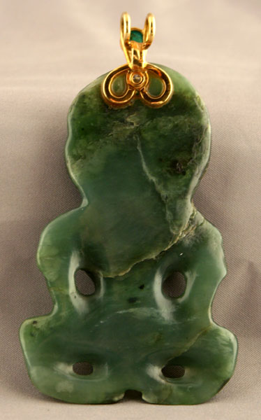 Maori Jade Hei Tiki Amulet Mounted in a Gold Pendant Clasp with and Emerald and Diamond
