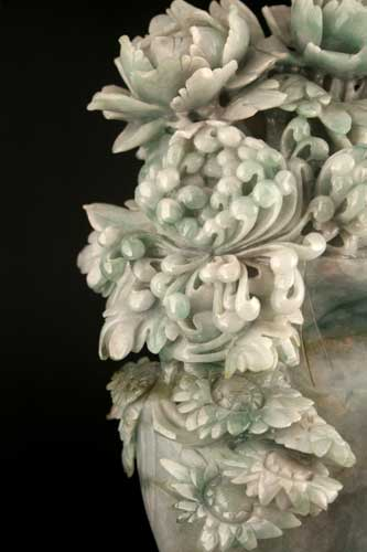 Jade Sculpture Depicting a Vase with Flowers and Birds