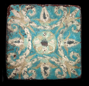 Assyrian Glazed Brick Tile Depicting a Floral Motif