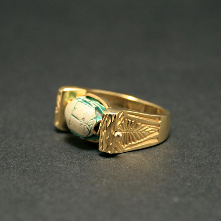 18 Karat Gold Ring Featuring a Faience Scarab