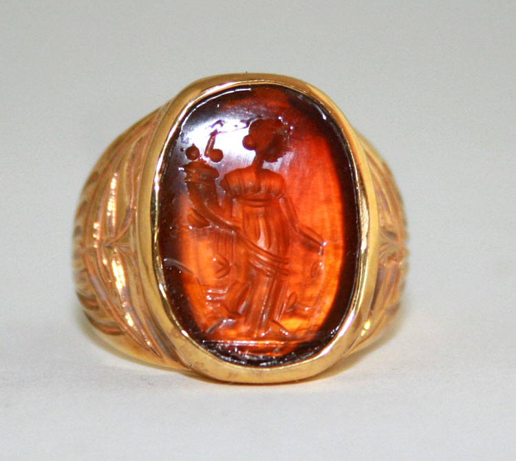 Carnelian intaglio depicting the goddess Fortuna mounted in an 18 Karat Gold Ring