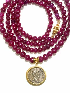 Silver Denarius Of Roman Emperor Antonius Pius Set In A Necklace With Ruby Beads & A 14 Karat Clasp