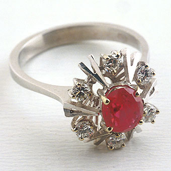 White Gold Ring Featuring a Ruby Surrounded by Six Diamonds