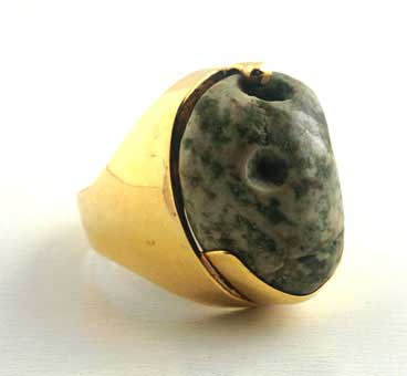 Gold Ring Featuring a Mottled Jadite Face Pendant