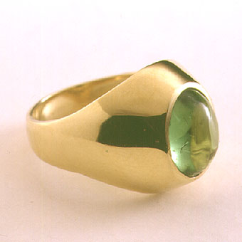 Green Cabochon Tourmaline Ring Weighing 2.5 Carats Set In 18 Karat Gold