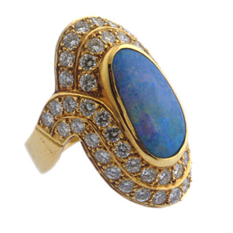 Gold Ring Featuring an Australian Opal Ring Set with Fifty Three Diamonds