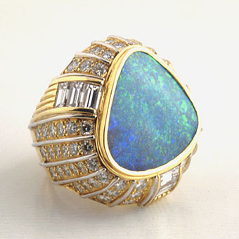 Diamond Studded Gold Ring Featuring an Australian Opal