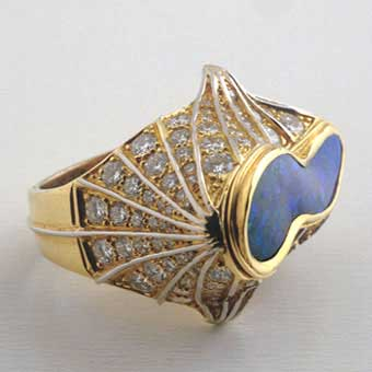 Diamond Studded Gold Ring Featuring an Australian Boulder Opal