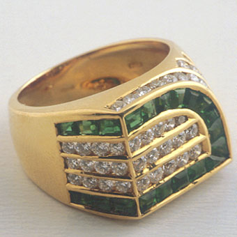 Gold Ring Set with 21 emeralds and 27 diamonds