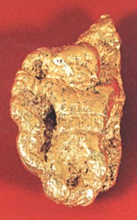 Veraguas Gold Nugget with a Carved Figure