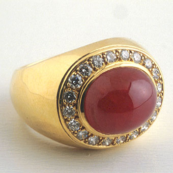 Gold Ring Featuring a Cabochon Ruby Surrounded by Twenty Diamonds