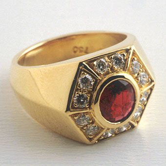 Gold Ring Featuring a Ruby Surrounded by Twelve Diamonds