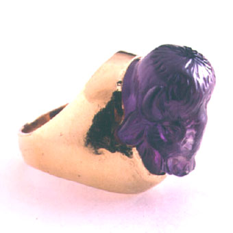 Gold Ring Featuring an Amethyst Sculpted in the Shape of a Bison Head