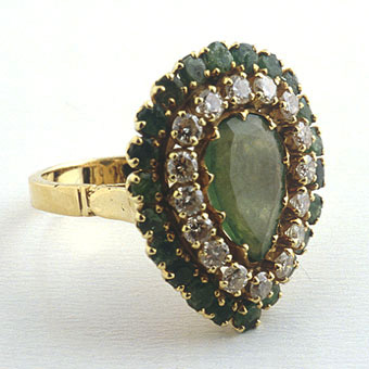 14 Karat Gold Ring with a Pear-Shaped Emerald Surrounded by 22 Small Emeralds and 16 Small Diamonds