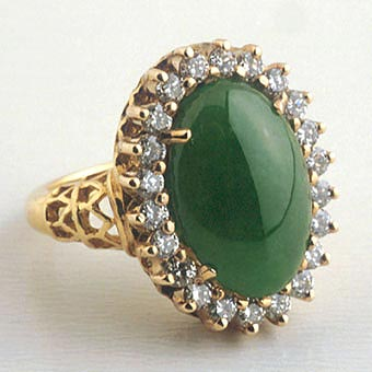 Gold Ring with a Cabochon Jade Surrounded by 22 Round Diamonds