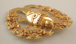 Gold Pectoral of a Turtle Surrounded by a Ring Featuring Eight Small Turtles