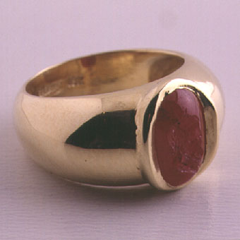 Gold Ring Featuring a Classical Revival Ruby Intaglio Depicting the Head of Zeus