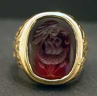 Gold Ring Featuring a Classical Revival Carnelian Intaglio of a Nest