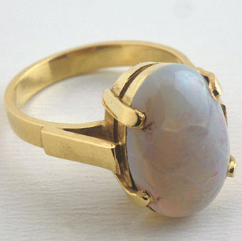 Ring Of 18 Karat Gold Set With A Opal Weighing 3.65 Carats