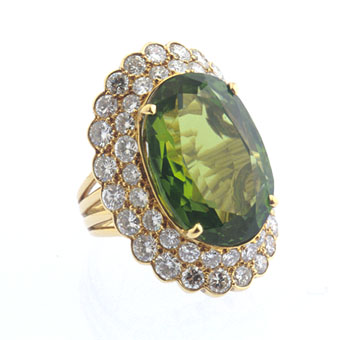 Diamond Studded Gold Ring with a Peridot