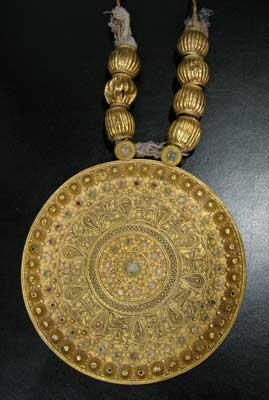 Large Gold Pendant with Applied Decoration