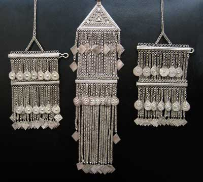 Set of Three Silver Clothing Ornaments