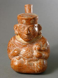 Moche Jar Depicting a Figure Holding a Duck