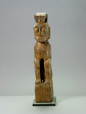 Indonesian Wooden Sculpture of a Seated Man