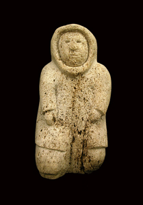 Inuit Bone Sculpture of a Kneeling Man