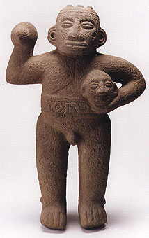 Basalt Standing Male Figure Holding Trophy Head