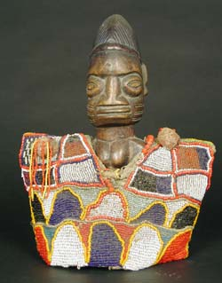 Yoruba Ibeji Doll Wearing a Beaded Cloak