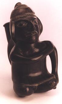 Chimu Greyware Stirrup Vessel in the Form of a Seated Male