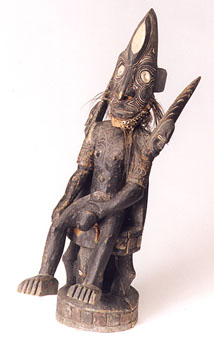 New Guinea Wood Sculpture of a Seated Man