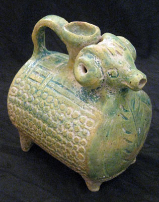 Parthian glazed ewer in the shape of a ram