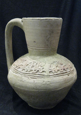 Unglazed Earthenware Jug with Moulded Decoration