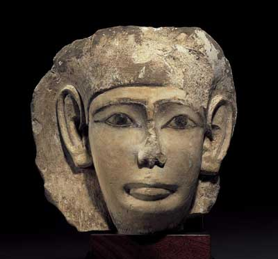 Limestone Fragment of a Face from a Sarcophagus Lid