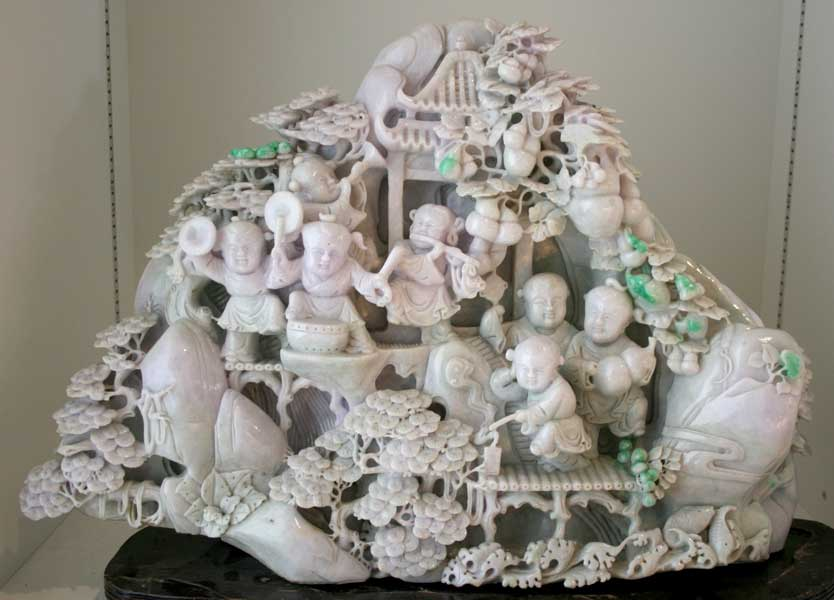Lavender Jade Sculpture Depicting Musicians