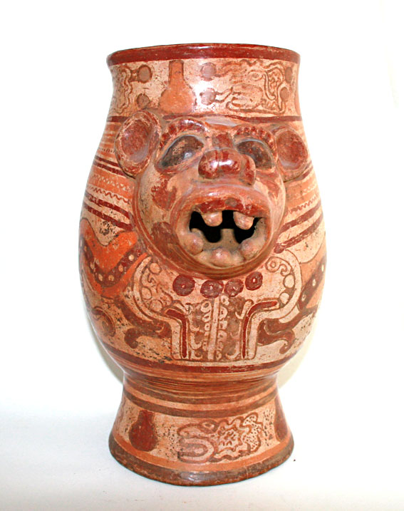 Terracotta Vessel Featuring an Animal Head