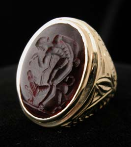 Gold Ring with Classical Revival Garnet Intaglio of a Man Feeding a Dog