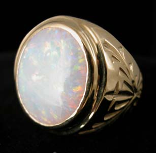 Gold Ring with Oval-Shaped White Opal