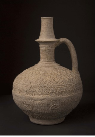 Islamic Terracotta Jug with Molded Decorations