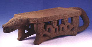 Basalt Metate in the Form of a Jaguar with Human Figure Seated in Between the Legs
