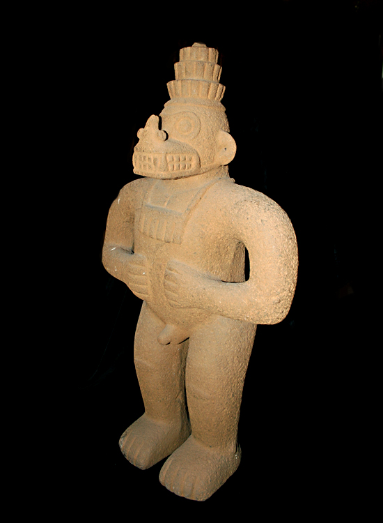 Basalt Sculpture Of A Standing  Masked Figure
