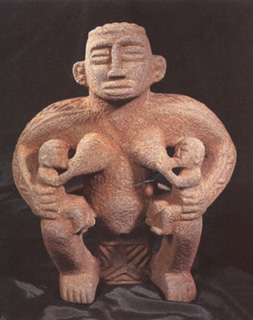 Basalt Sculpture of a Mother Nursing Twins