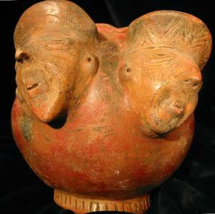 Slanted Bowl With Two Male Head  Figures