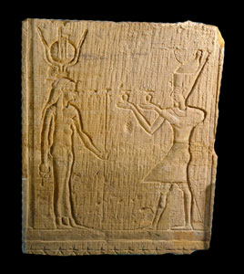 Relief Stele Depicting a Pharaoh Making an Offering to the Goddess Isis